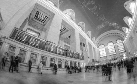 People and Tourists moving in Grand Central, New York City photo