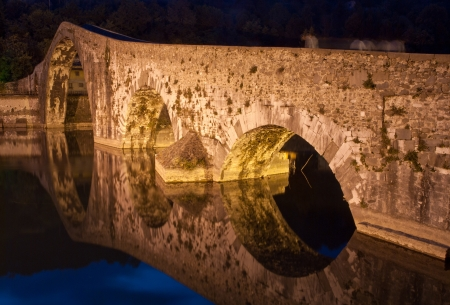 Colors and Reflections of Devils Bridge at Night, Italy photo
