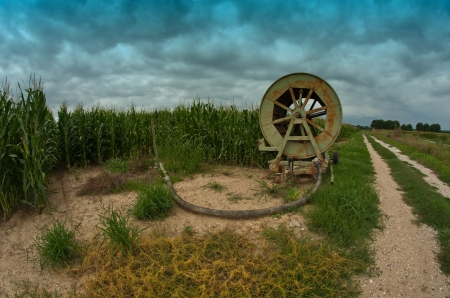 agriculture machinery: Agriculture Machinery in a Tuscan Meadow, Italy Stock Photo