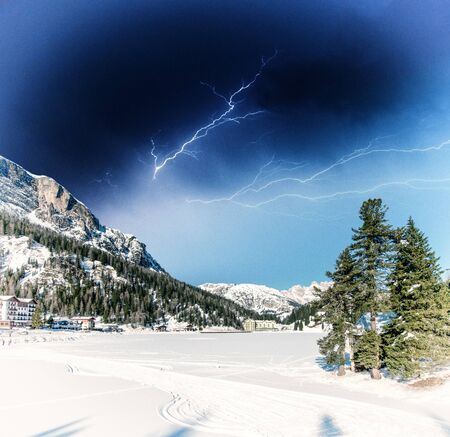 Beautiful colors of Dolomites Landscape in Winter with Storm  photo