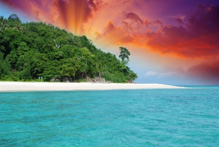 Sunset over Bamboo Island in Thailand photo