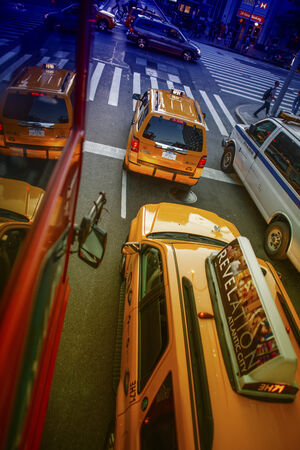 taxicabs: NEW YORK CITY - JUN 14: Yellow cabs speed up in city streets, June 14, 2013 in New York City. There are currently more than 13,000 licensed taxicabs in the Big Apple