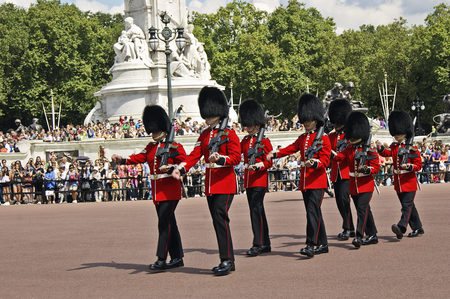 regiment: Changing the Guard at Buckingham Palace is a ceremony lasts about 45 minutes where one regiment takes over from another. Editorial