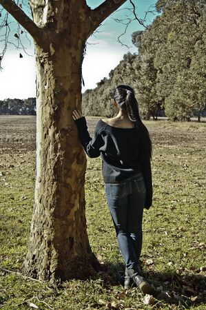 beaty: A sadhappy and thinking teenager under a tree in a countryside of Mar del Plata, Argentina
