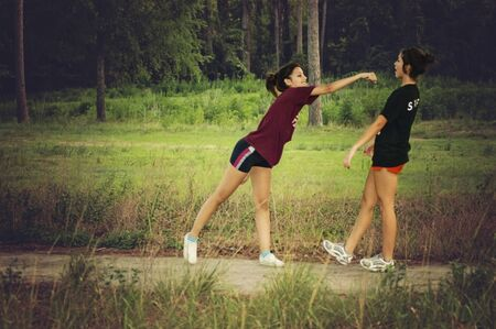atractive: Teenagers jumping in a forest in Houston, Texas, USA Stock Photo