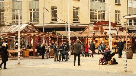 chalets: Bristol, UK - November 9, 2015:  the 7th German Christmas Market in Broadmead, Bristol. They are 38 traditional chalets decorated with festive greenery and colorful lights where you will find traditional German Christmas decorations