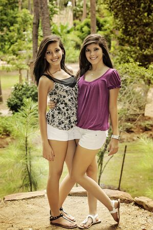 fine legs: two young women posing  in a beautiful park of Houston in a summer day Stock Photo