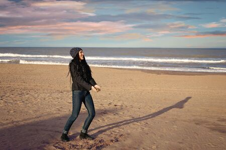 teenager playing in winter in a beach of Mar del Plata, Argentina