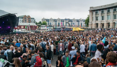 gig harbor: Bristol, UK - July 16, 2016: An audience at the Cascade Steps stage shows its appreciation for one of the bands at the annual Harbour Festival in Bristol UK