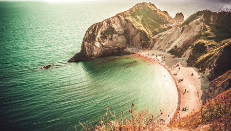 counties: Durdle Door,a very popular beach of sand and fine pebbles on the Jurassic Coast, Dorset, England, United Kingdom