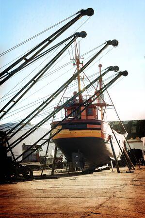 Cranes and boat at Mar del Plata Shipyard , Argentina