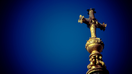 Cross at the top of St Pauls Cathedral in London,England