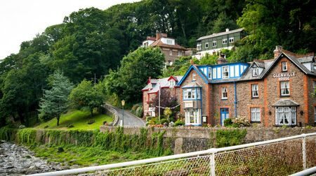 lynmouth: Lynmouth, UK - July 27, 2016: Glenville House on bank of East Lyn River Lynmouth Devon UK