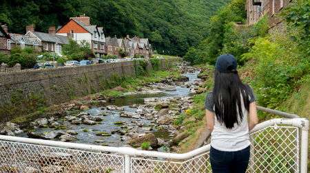 lyn: girl looking up the valley of the East Lyn River,   in Lynmouth in North Devon England UK