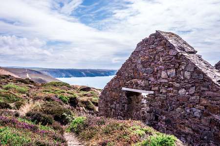 Stamps and wheel engine house ruins Wheal Coates mine on cliffs near St. Anges,  Cornwall, UK