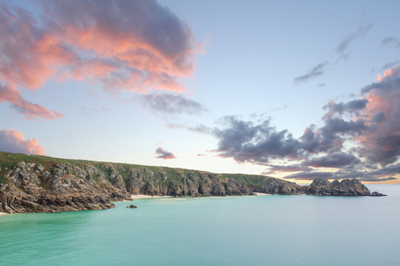 Logan Rock headland at Porthcurno in Cornwall UK Stock Photo