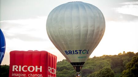 Bristol, UK - August 13, 2016: The Bristol International Balloon Fiesta 2016, showing the mass ascent and landings of over 100 balloons including special shapes and the night glow, where the burners are used at night to illuminate the balloons. This ann Redactioneel