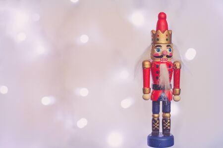 Wooden Nutcracker soldier Christmas decoration with sparkling  in background