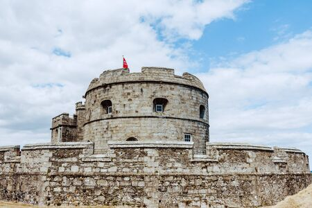 Falmouth, Cornwall, England - July 25, 2018: Pendennis castle was first commissioned by King Henry VIII in response to invasion threats from the continent. Pendennis was built on the mouth of the Rive 報道画像