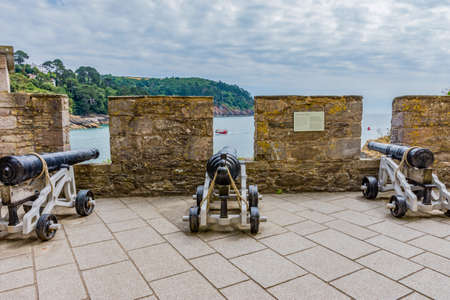 26 July 2018 - Dartmouth, Devon, UK: Canon at Dartmouth Castle on the estuary of the river Dart, Devon. The Castle is an artillery fort, built to protect Dartmouth harbour. The earliest parts of the castle date from the 1380s