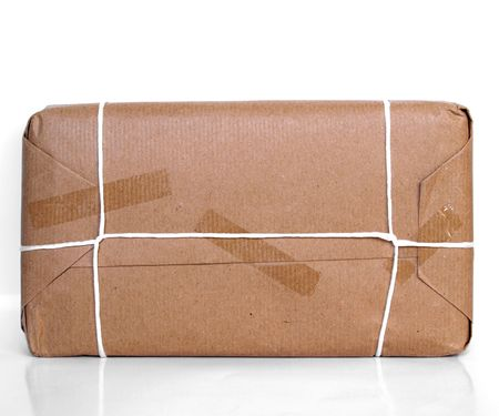 Parcel packet over a white background with reflection Stock Photo - 5294899