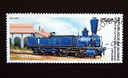 Republic of Guinea postage stamp with train photo