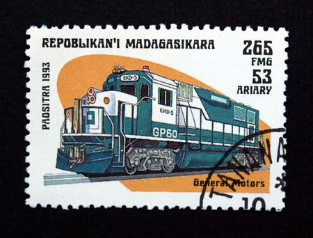 Madagascar stamp with train on black