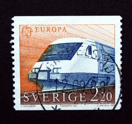 Sweden stamp with train on black Stock Photo - 5294898