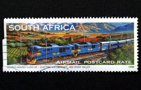 South Africa stamp with train on black