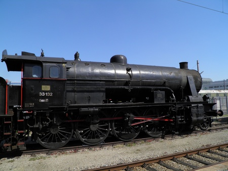 Steam engine train locomotive in a station