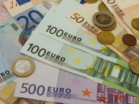 Euro (EUR) banknotes and coins money useful as a background or money concept Stock Photo - 18339594