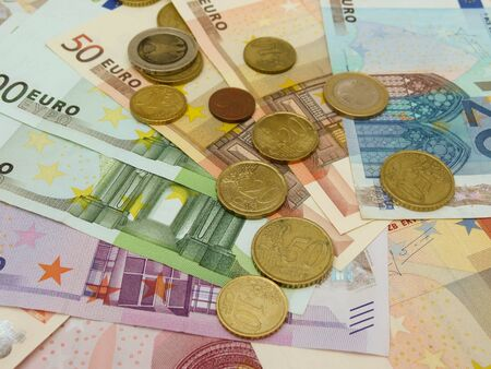 Euro (EUR) banknotes and coins money useful as a background or money concept Stock Photo - 18339598