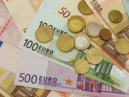 Euro (EUR) banknotes and coins money useful as a background or money concept Stock Photo - 18356229