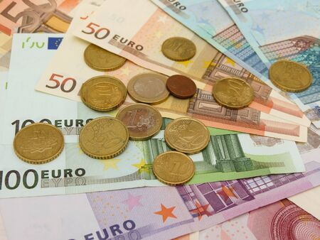 Euro (EUR) banknotes and coins money useful as a background or money concept Stock Photo - 18356219