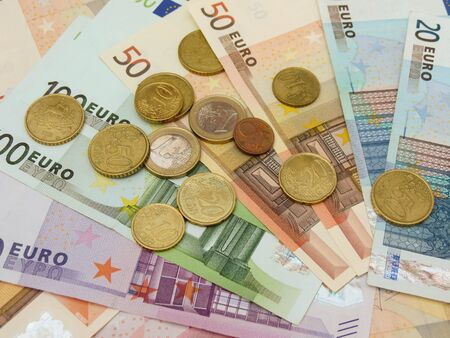 Euro (EUR) banknotes and coins money useful as a background or money concept Stock Photo - 18356262