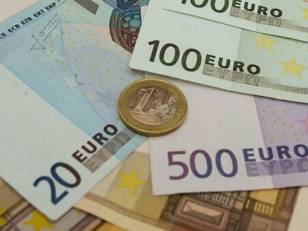 Euro (EUR) banknotes and coins money useful as a background or money concept Stock Photo - 18356205
