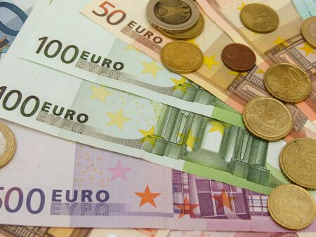 Euro (EUR) banknotes and coins money useful as a background or money concept Stock Photo - 18356231
