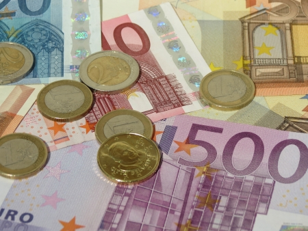 Euro (EUR) banknotes and coins money useful as a background or money concept - with a coin from Vatican (Pope Benedict XVI) Zdjęcie Seryjne