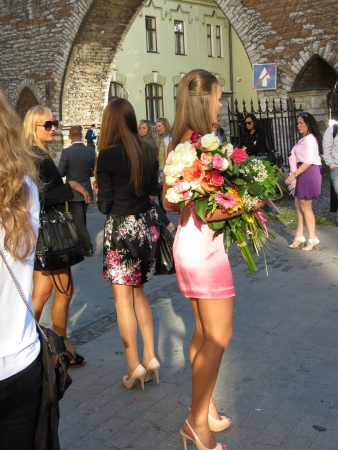 TALLINN, 20 JUNE 2012 - unidentified sexy girls with elegant dress and flowers attending a ceremony in Tallinn, 20 June 2012