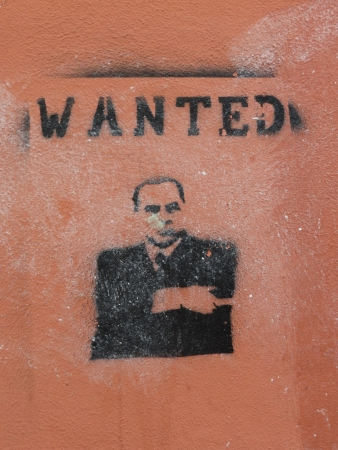 opponents: Silvio Berlusconi wanted - stencil painted on walls by his opponents