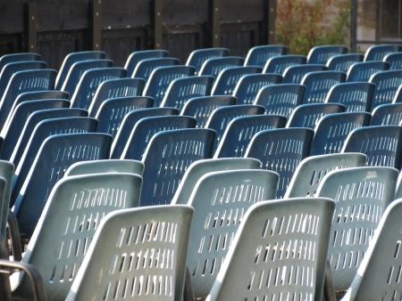 rows of plastic chairs in an open air theatre or cinema or auditorium photo