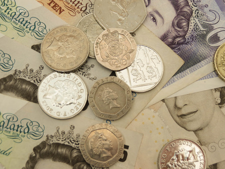 gbp: British Sterling Pounds (GBP) banknotes and coins bearing the portrait of Queen Elizabeth II Stock Photo