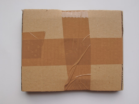 fibreglass: cardboard parcel sealed with adhesive tape useful as shipping concept or as background Stock Photo