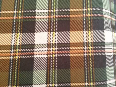bedcover: brown and orange tartan cotton fabric Stock Photo