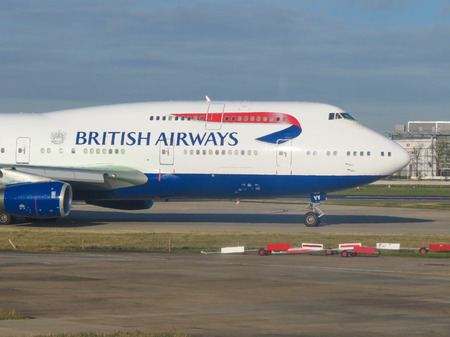 LONDON HEATHROW, UK - CIRCA DECEMBER 2014: Boeing 747 Jumbo aircraft of the British Airways on the runway ready for take-off