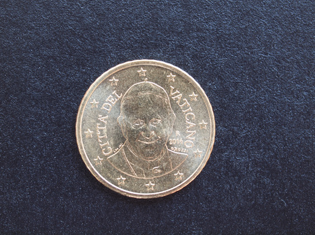 francesco: Fifty Euro cent coin from Vatican City bearing the portrait of Pope Bergoglio Francis I isolated over black background Stock Photo