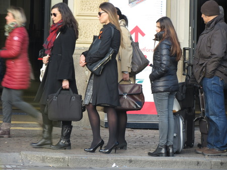 queueing: BOLOGNA, ITALY - circa november 2014: people queueing in front of the main train station Editorial