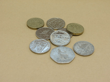 pounds: British Pounds coins (currency of United Kingdom)