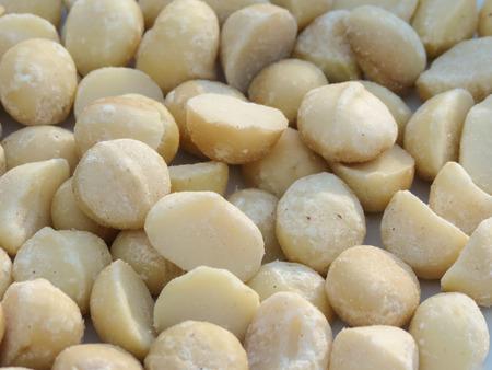 Natural macadamia (Macadamia integrifolia) nuts food background Stock Photo