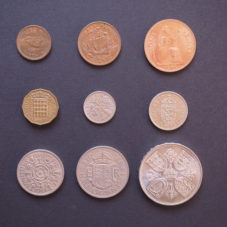 decimal: LONDON, UK - CIRCA DECEMBER 2014: Full range of Predecimal British Pound coins, withdrawn on Decimal Day, i.e. 15 February 1971